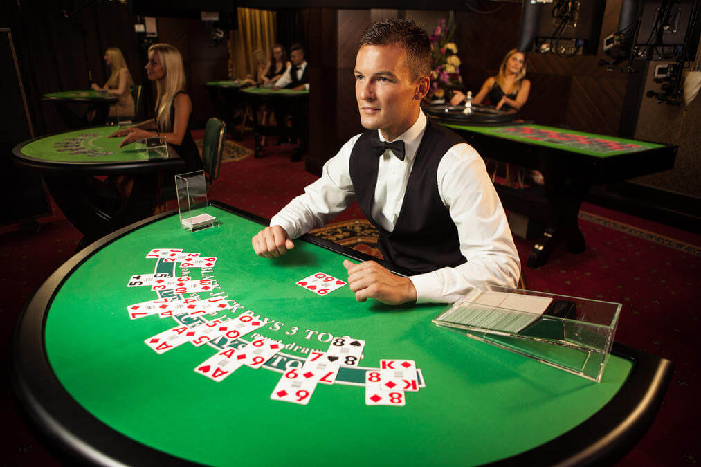 A live casino dealer and blackjack table